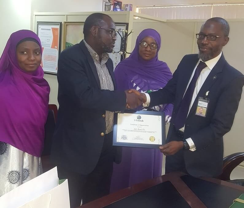 Abdullateef Aliyu of 1-Ummah presenting Letter of Appreciation to Hassan Usman, MDCEO